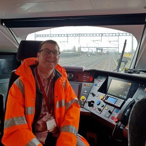 picture of Garry in electric train cab
